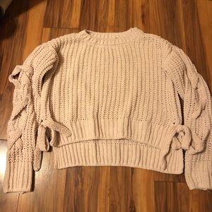 Candice's cream knit sweater